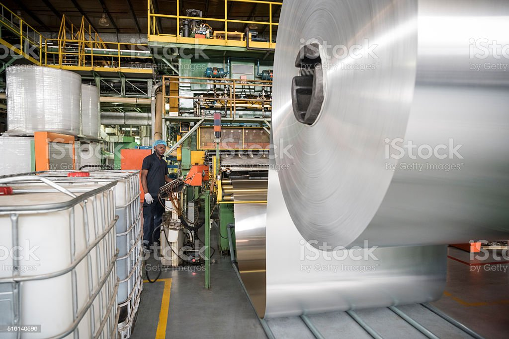 Large roll of aluminium in processing plant stock photo