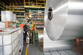 Large roll of aluminium in processing plant