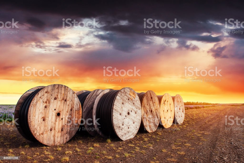 Large rolls of black wires against the blue sky stock photo