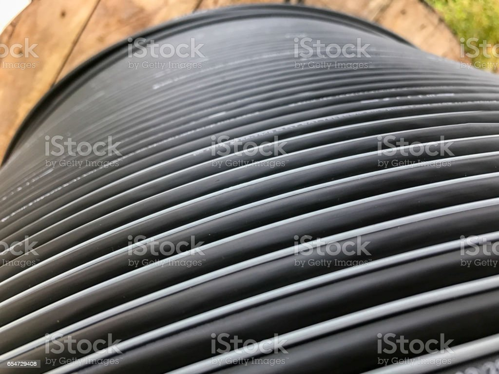 Large rolls of black wires stock photo