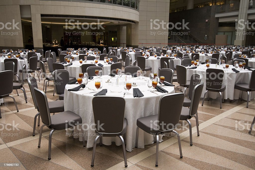 Large Room Set Up for a Banquet, Round Tables stock photo