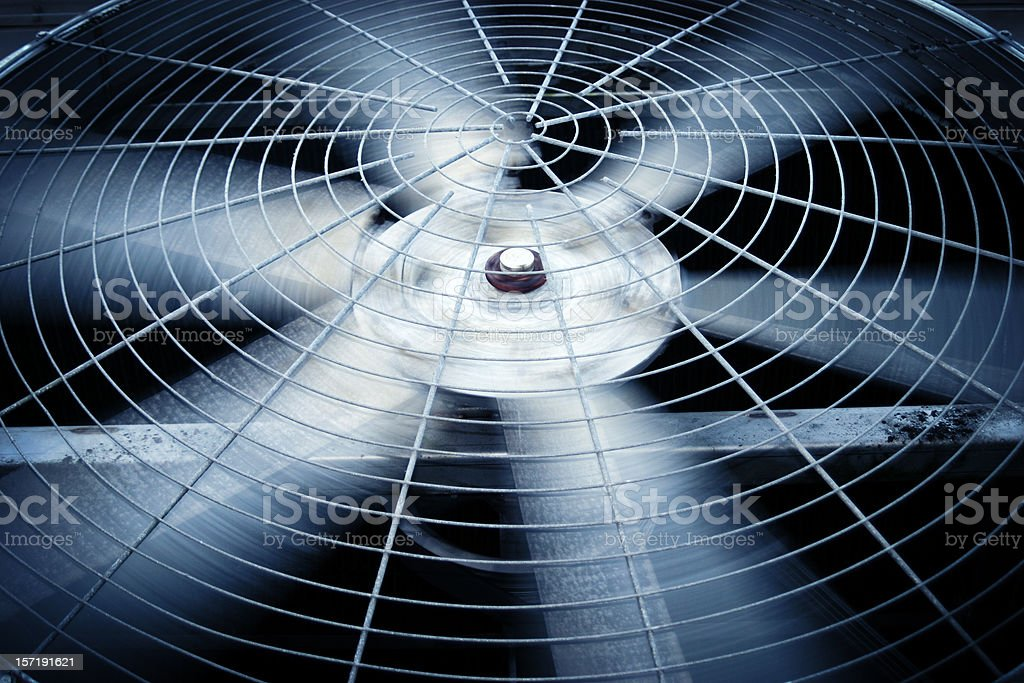 Large rotating fan of a commercial or industrial HVAC system stock photo