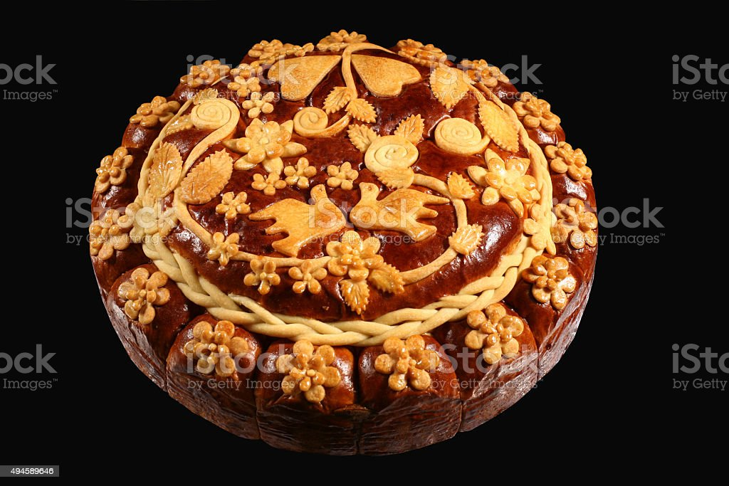 large round loaf with ornament on black background stock photo