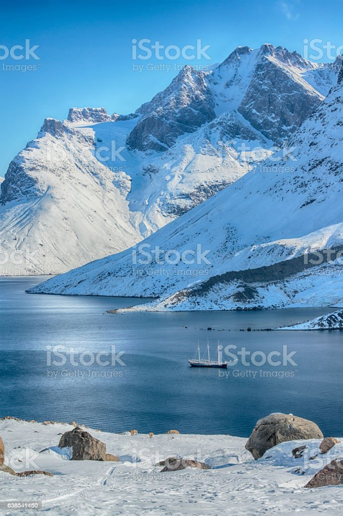 Large sailing ship in a scenic fjord, Western Greenland stock photo