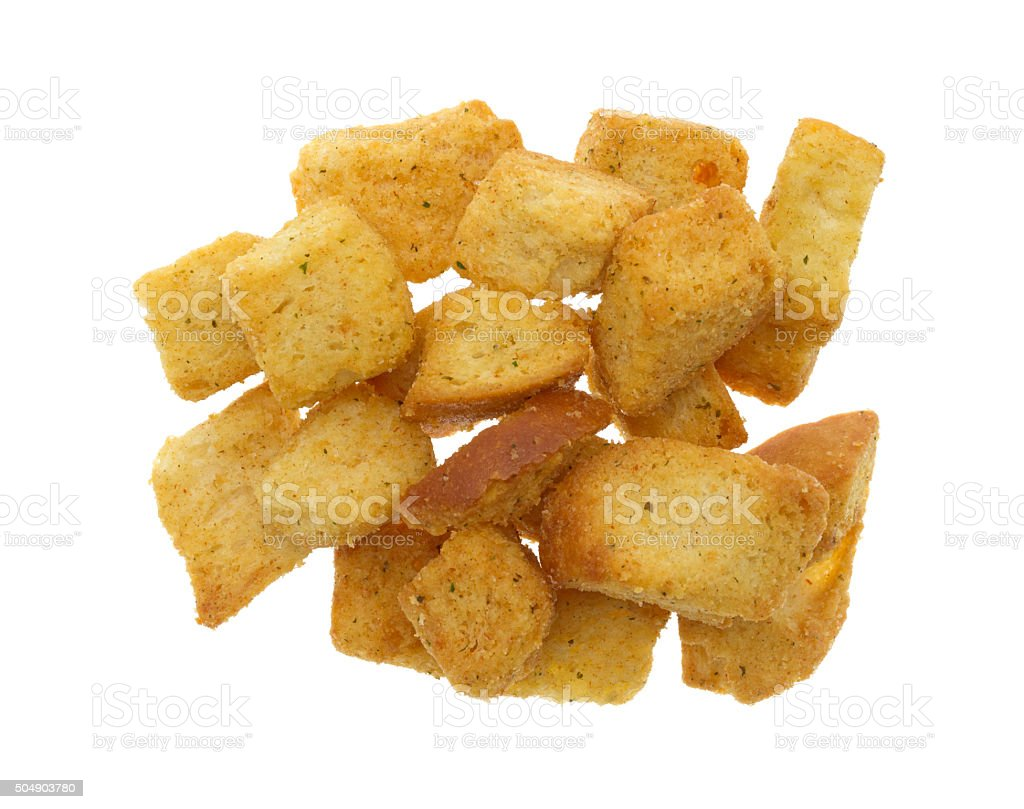 Large seasoned croutons on a white background stock photo