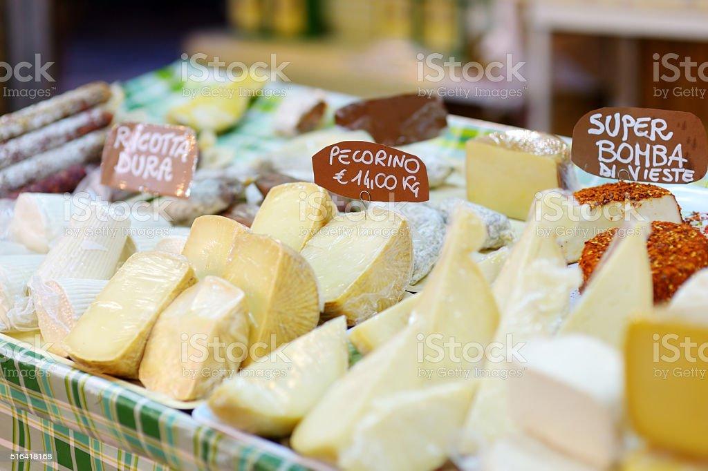 Large selection of cheeses on italian farmer market stock photo