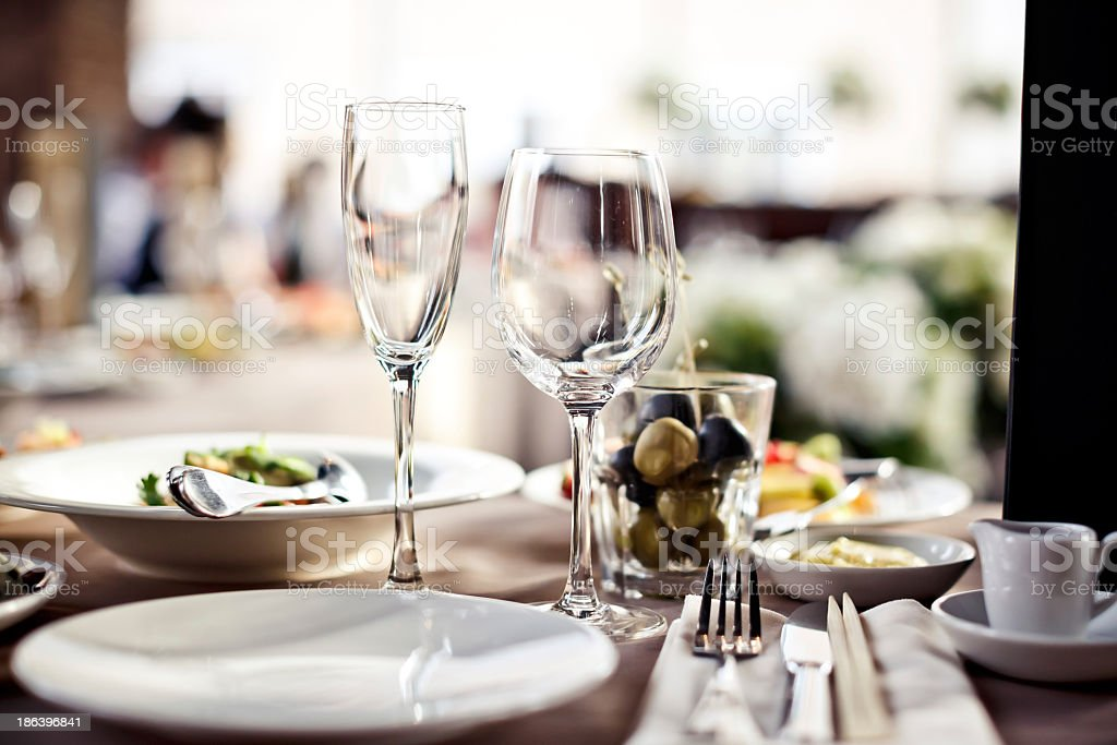 A large set of empty glasses in a restaurant stock photo
