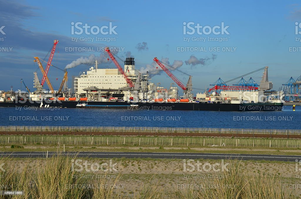 Large ship with cranes in the port of Rotterdam, Netherlands stock photo