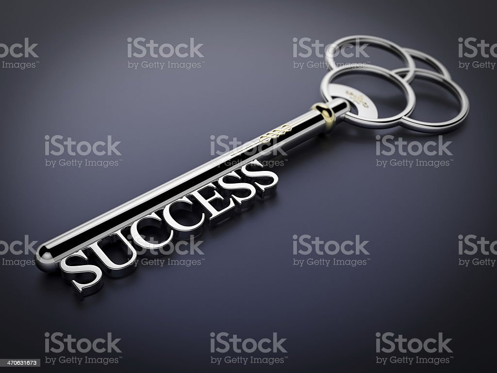 Large silver key with 'Success' text on dark blue stock photo