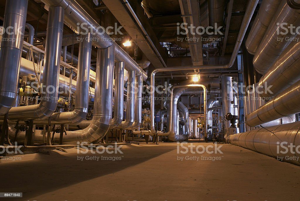 Large silver metal pipes in row in plant building stock photo