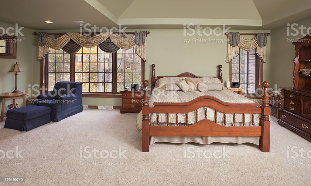 Large Spacious Master Bedroom With Sitting Area royalty-free stock photo