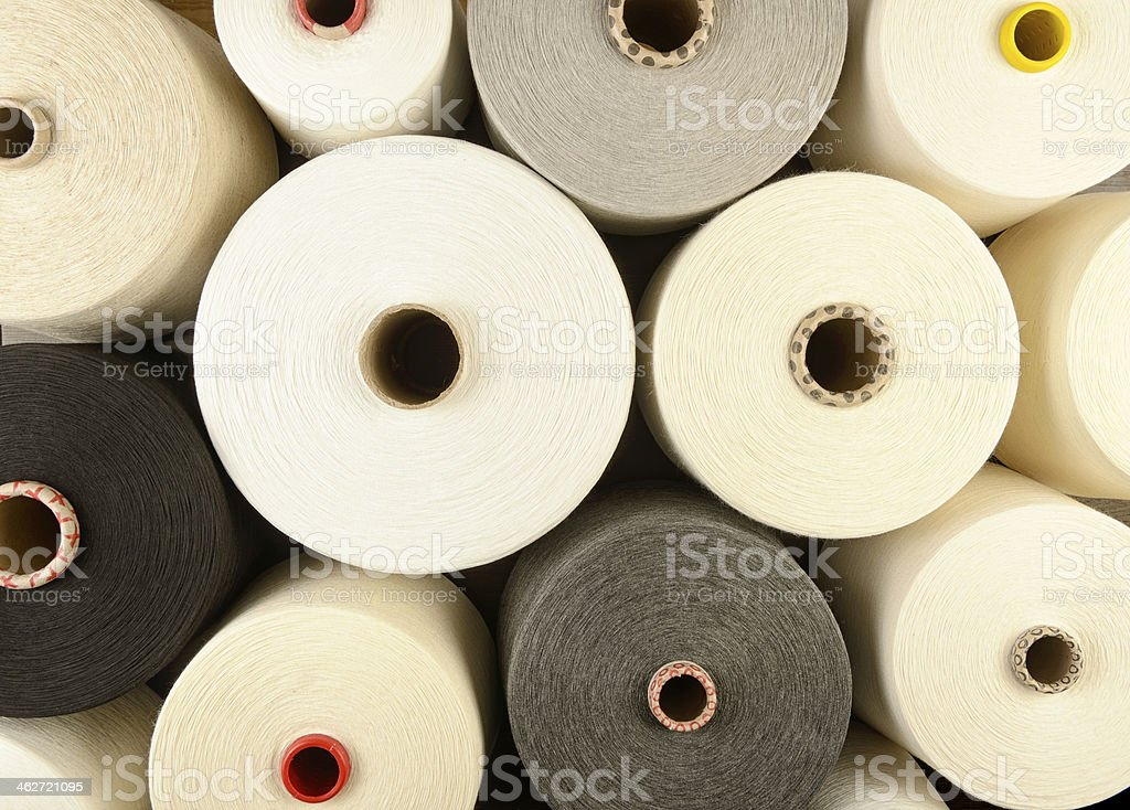 Large spools of multicolored yarn background stock photo