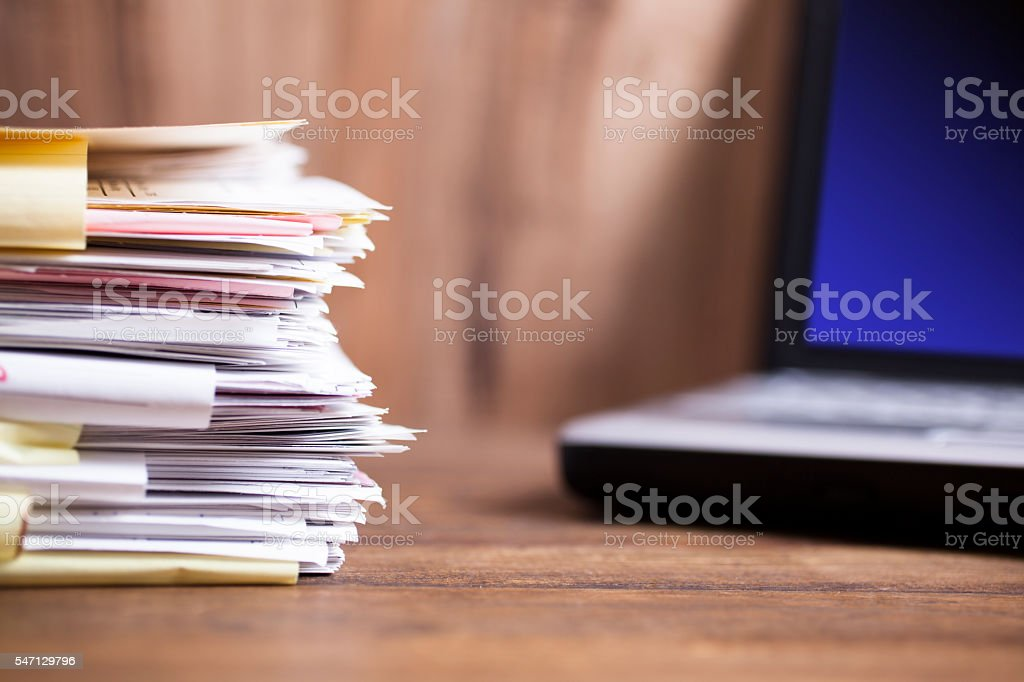 Large stack of files, paperwork.  Desk, office, computer. stock photo