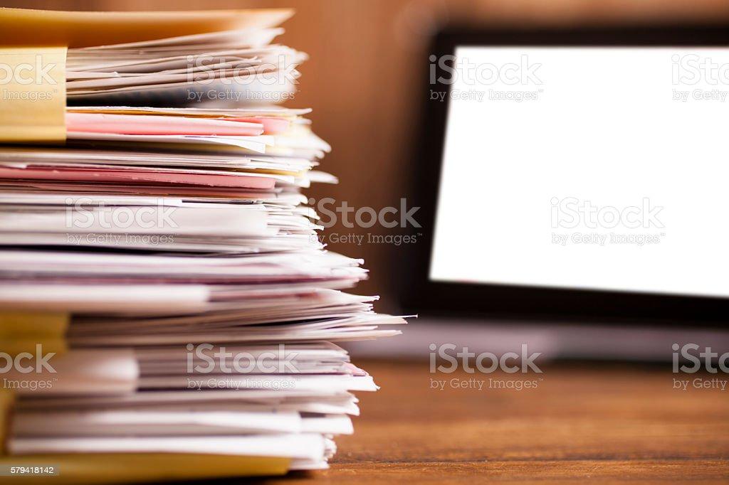 Large stack of files, paperwork.  Desk, office, digital tablet. stock photo