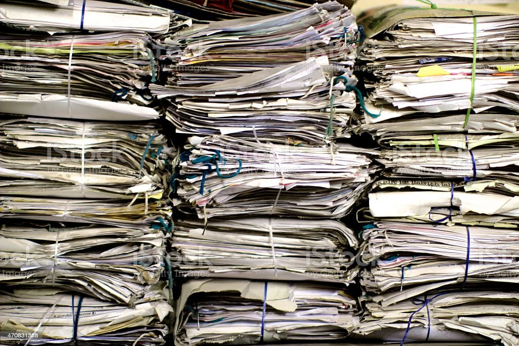 Large stack of newspapers and documents closeup stock photo