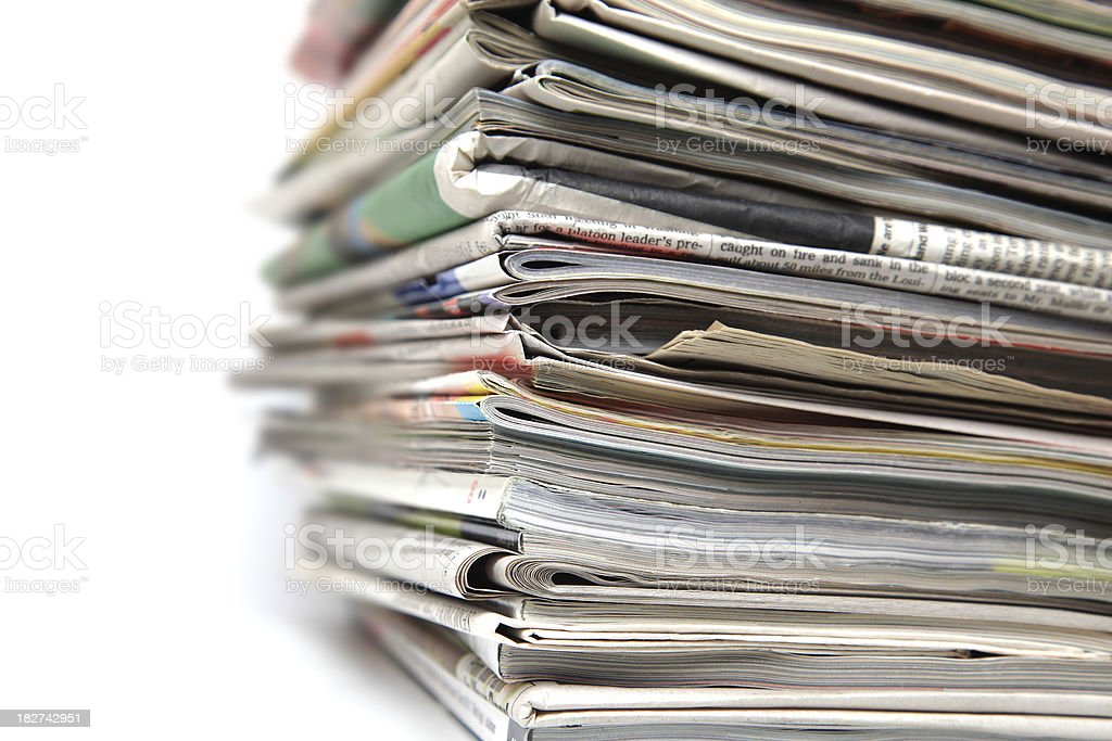 Large stack of newspapers and magazines on white background. royalty-free stock photo