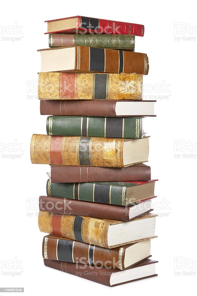 A large stack of older books in versions colors royalty-free stock photo