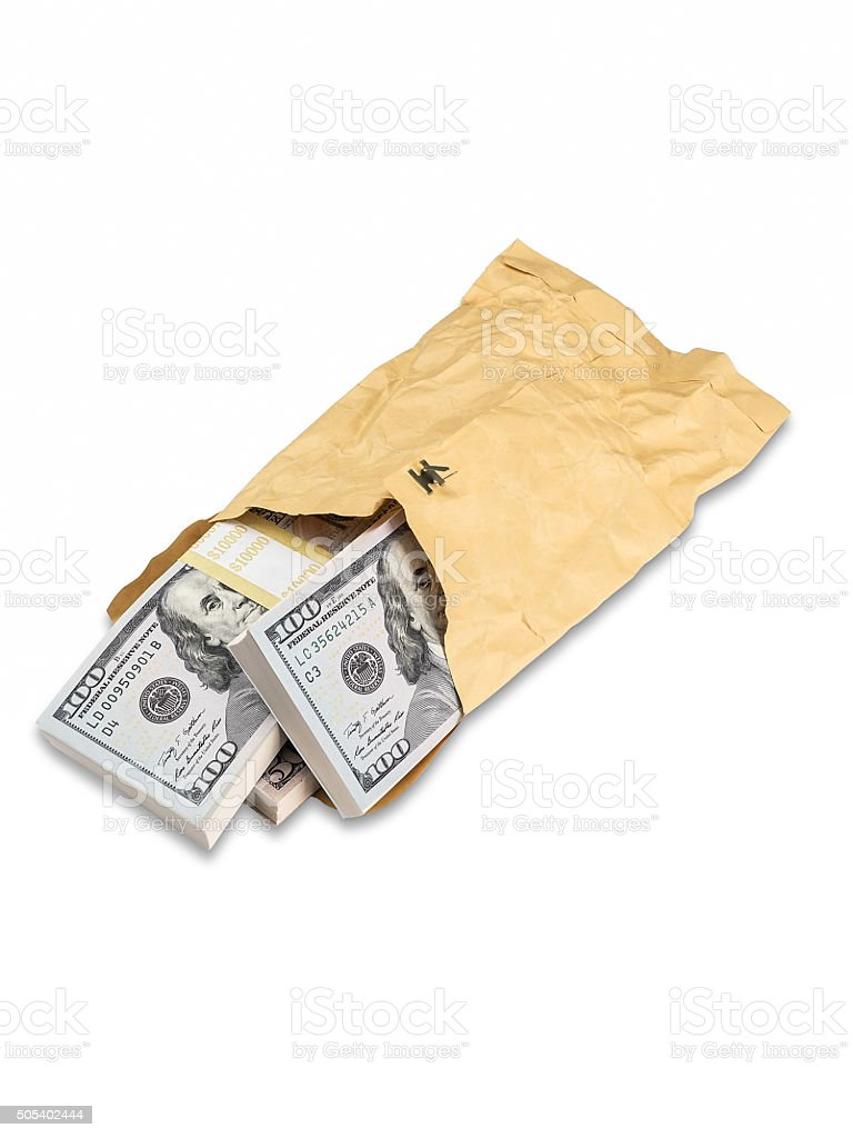 Large Stacks of U.S. Currency Are Stuffed Into Crumpled Envelope stock photo