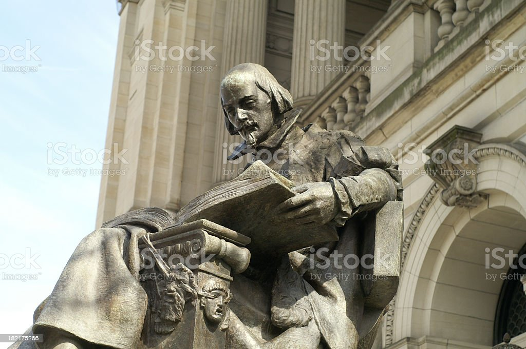A large statue of William Shakespeare royalty-free stock photo