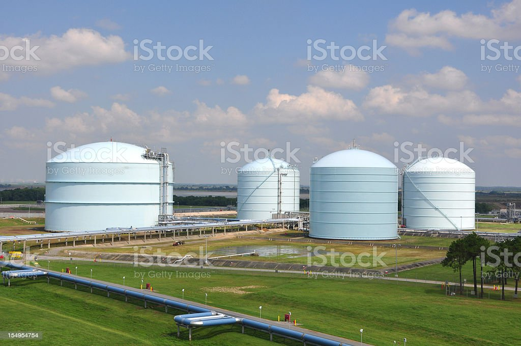Large storage tanks in a factory field stock photo