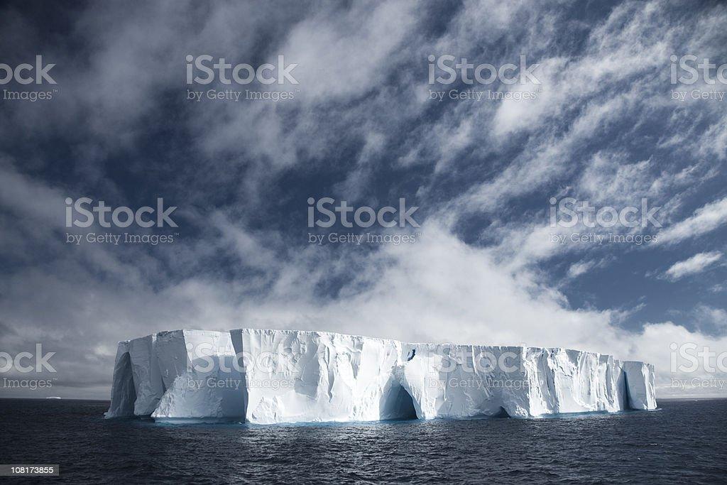 Large Tabloid Iceberg in Ocean royalty-free stock photo