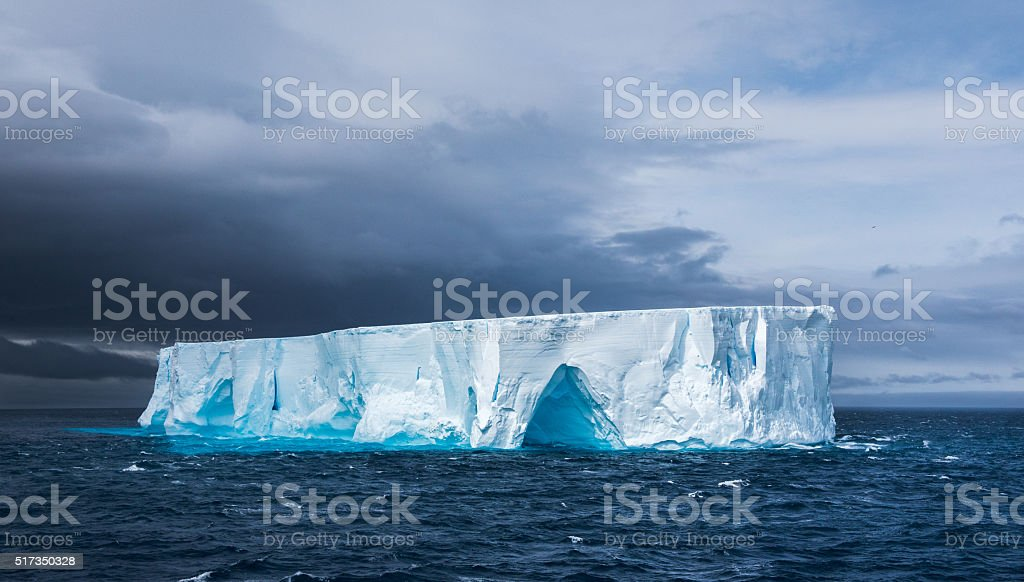 Large tabular iceberg floating in Antarctica stock photo