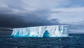 Large tabular iceberg floating in Antarctica
