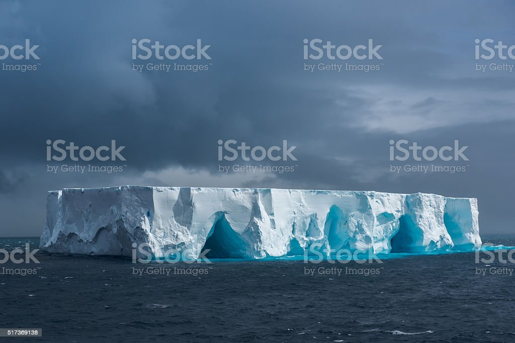 Large tabular iceberg floating in Antarctica stock photo