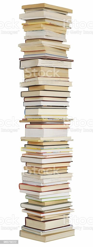 A large tall stack of books on a white background royalty-free stock photo