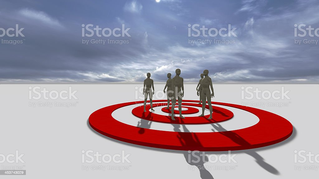 A large target with a group of four people stock photo