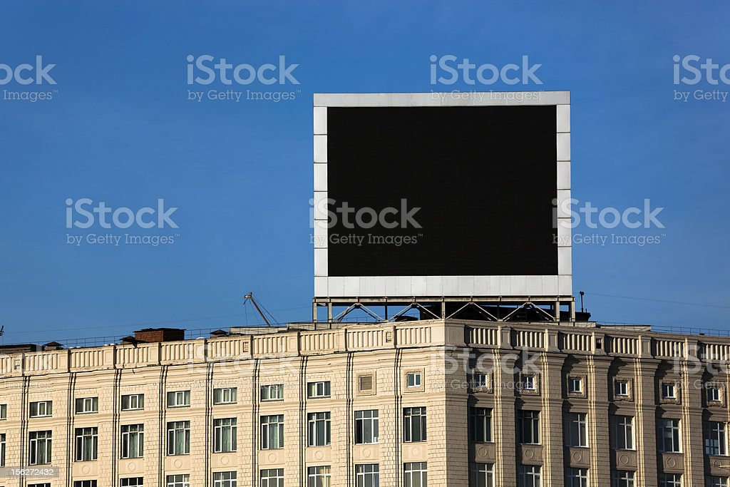 Large television blank billboard over blue sky stock photo