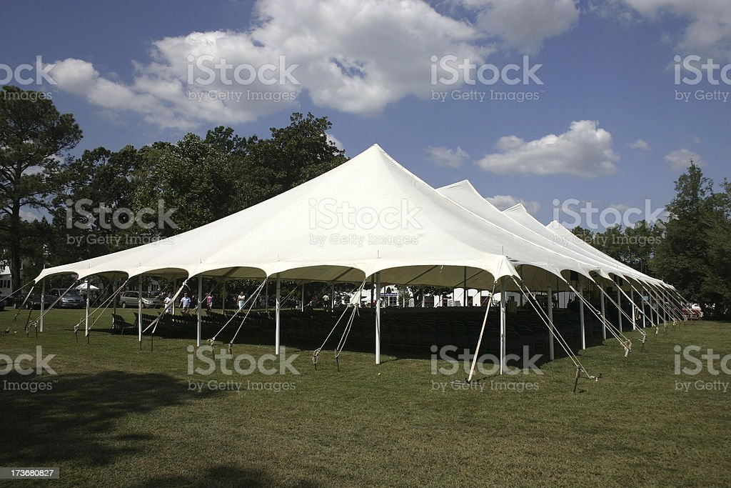 Large tent set up on the lawns for banquet stock photo