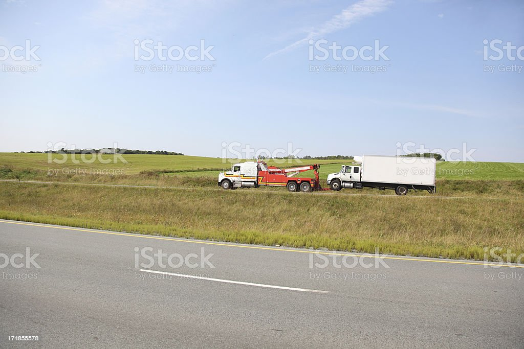 Large Tow truck towing royalty-free stock photo