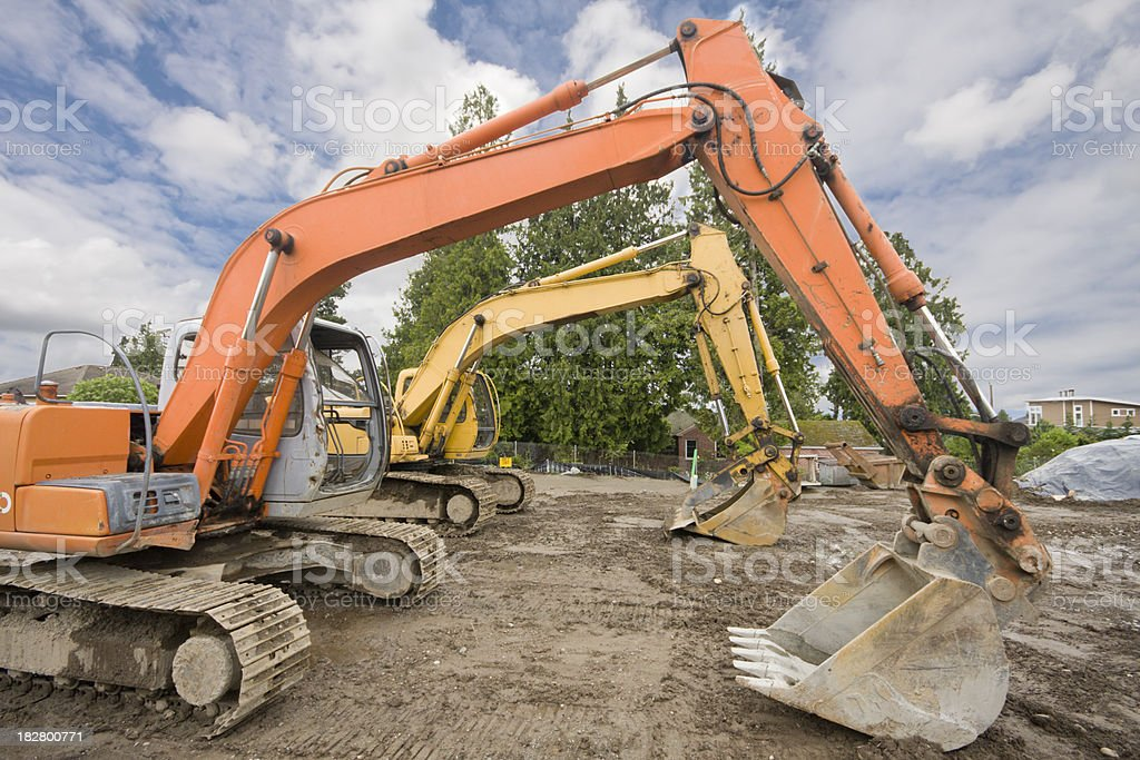 Large Trackhoes Lined up at Construction Site royalty-free stock photo