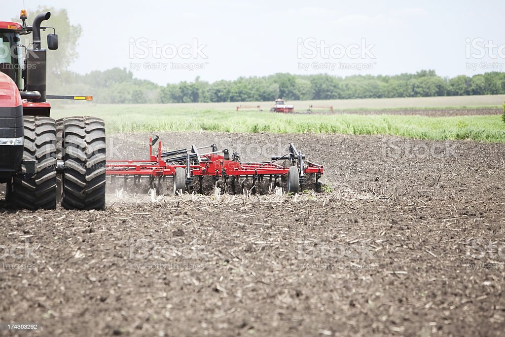 Large Tractor Plowing Spring Field royalty-free stock photo
