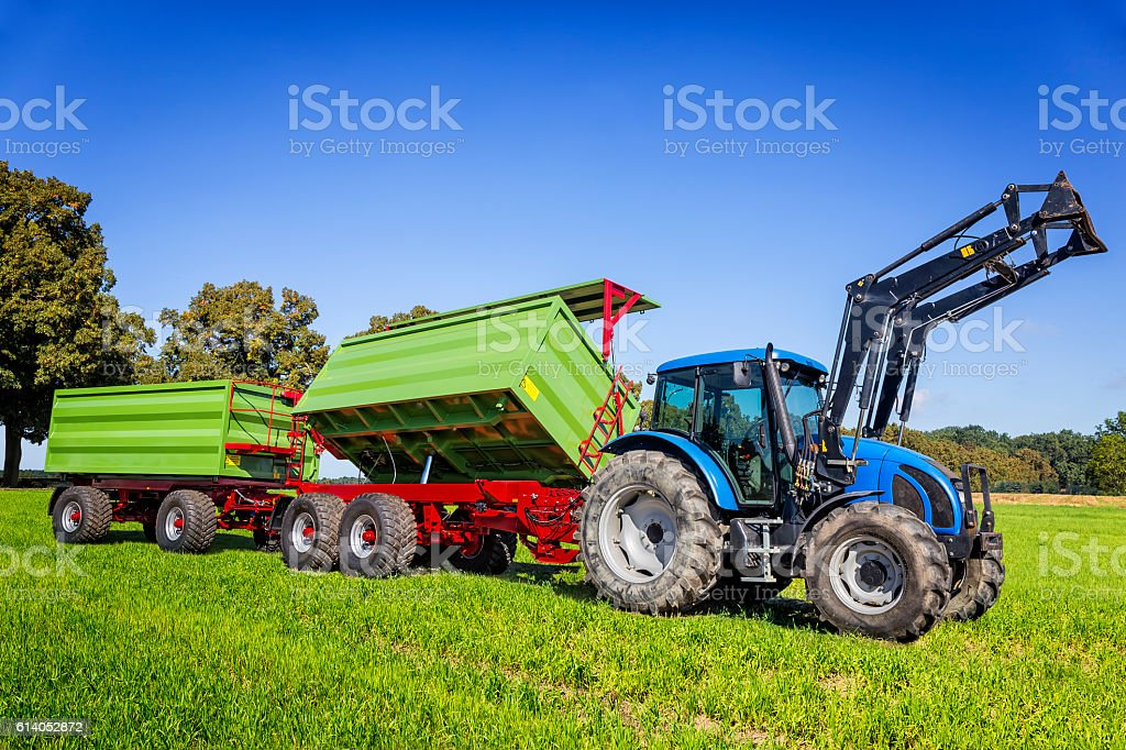 Large tractor with trailers on the plantation stock photo