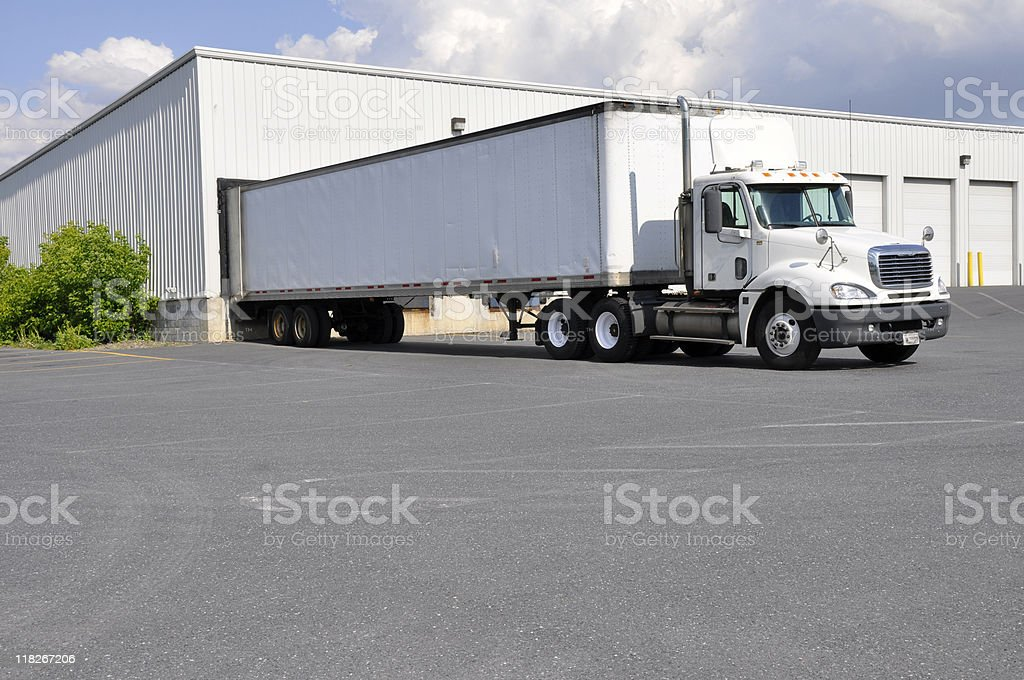 large truck and warehouse stock photo
