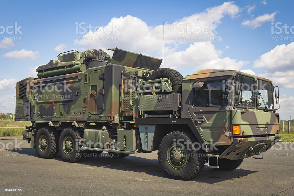 Large truck in a military camouflage royalty-free stock photo