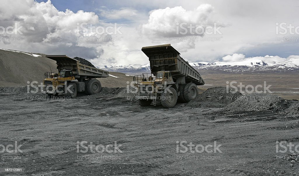 Large trucks at mountin gold mine stock photo