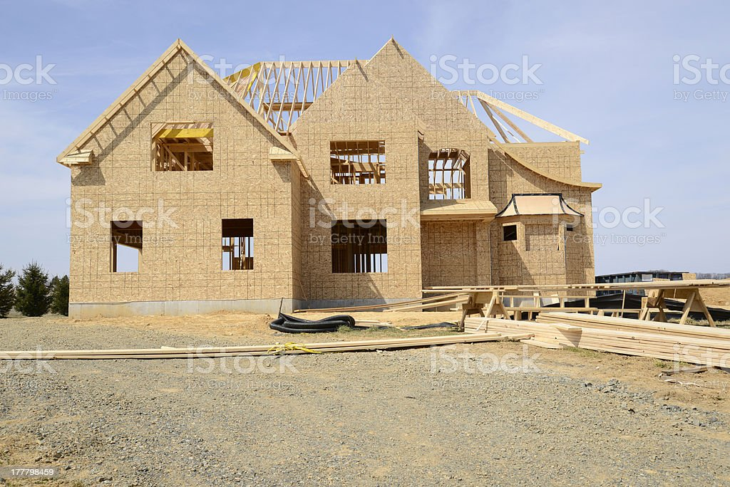 large two story family home under construction royalty-free stock photo