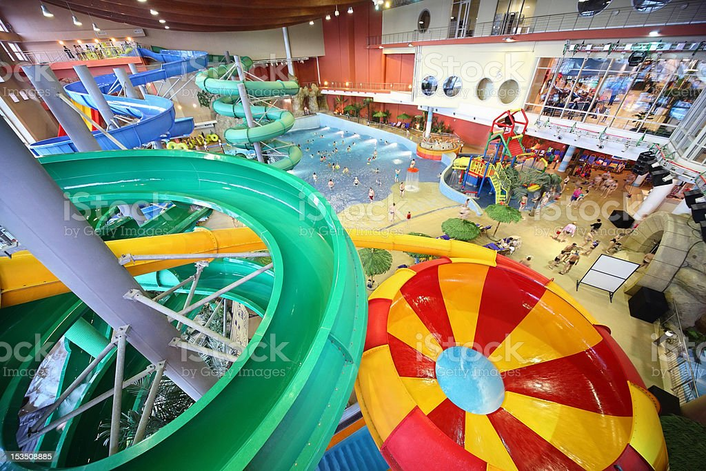 Large varicoloured chutes as spiral and pool in 'Kva-Kva' park. stock photo