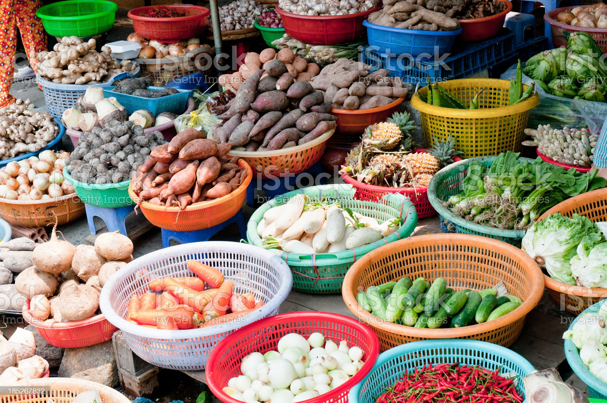 A large variety of vegetables in bowls at a street market royalty-free stock photo