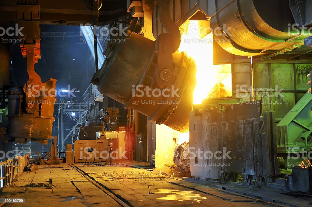 A large vessel pouring liquid metal royalty-free stock photo