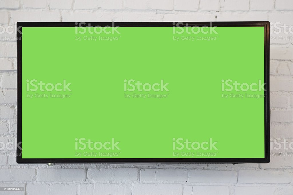 tv monitor mounted on a white brick wall with clipping path on screen...