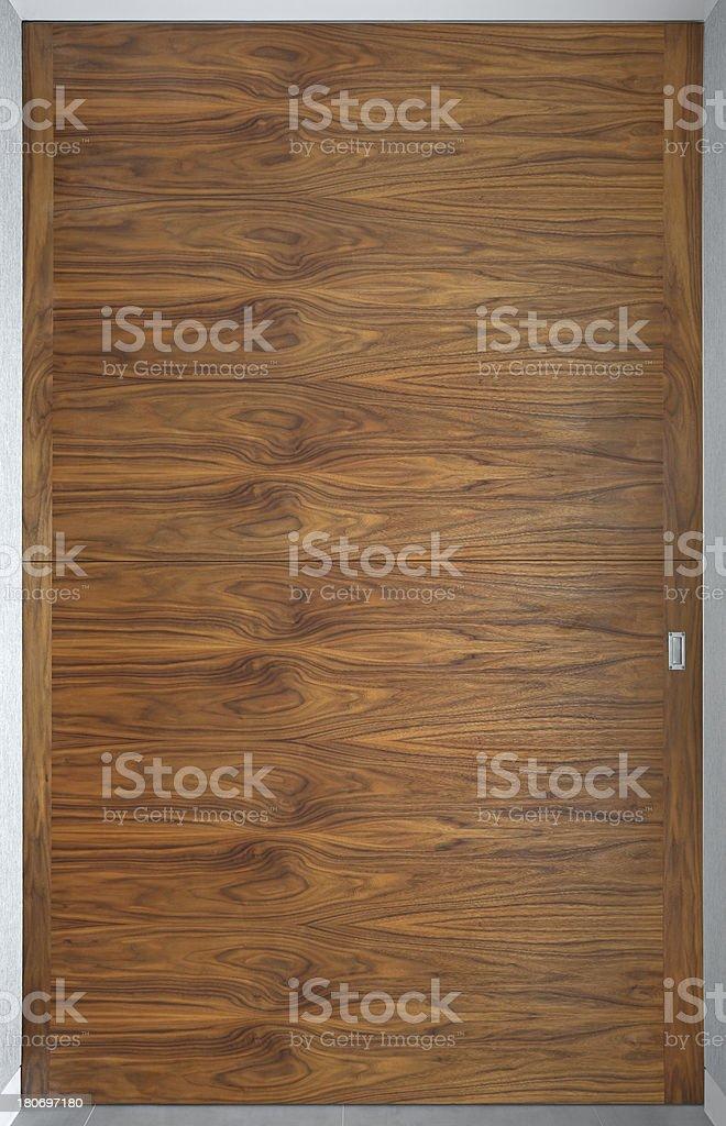 large walnut panelled sliding door royalty-free stock photo