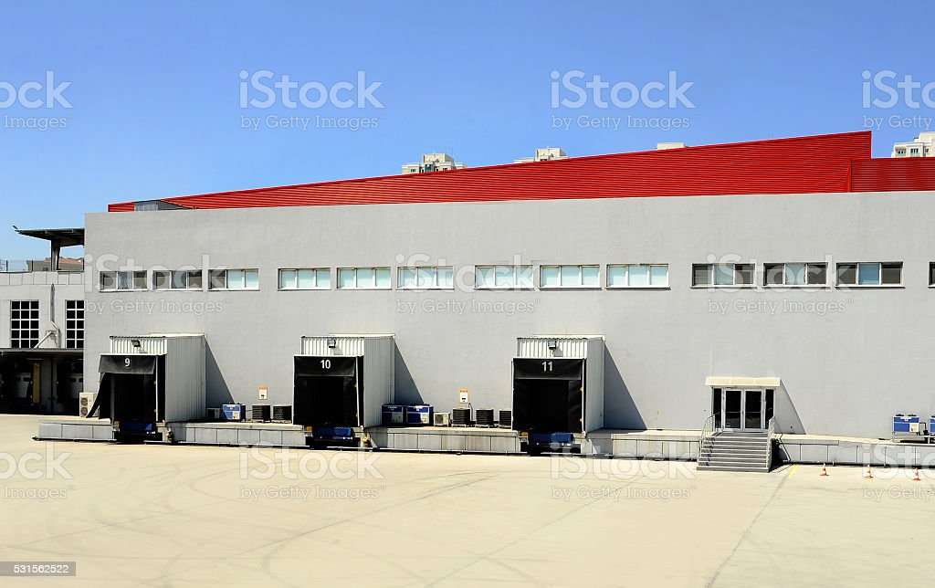 Large Warehouse Building And Parking lot stock photo