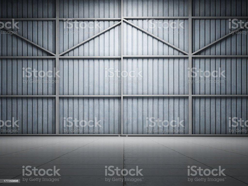 Large warehouse door illuminate stock photo