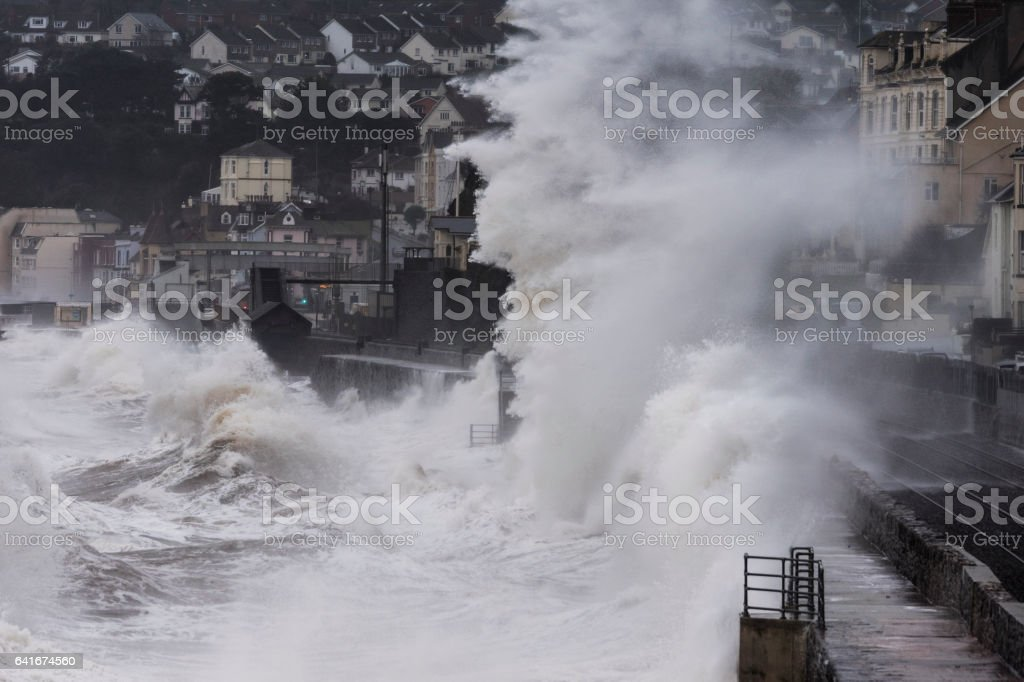 Large waves crashing over railway at Dawlish Devon stock photo
