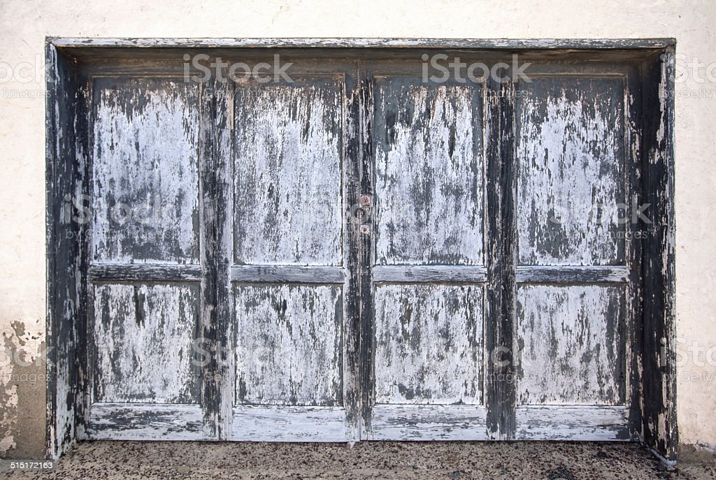 Large weathered wooden door in gray blue anthracite royalty-free stock photo