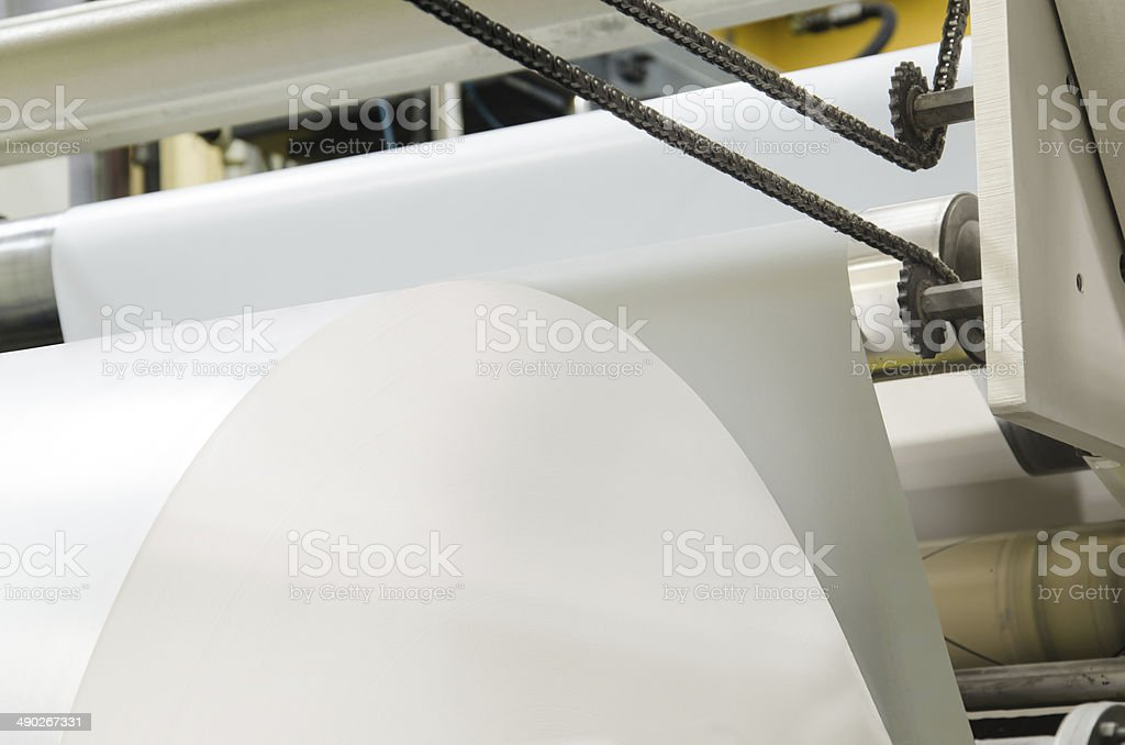Large webset offset printing press running a long roll paper stock photo